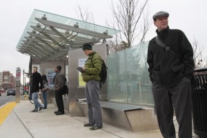 Riders wait for a bus at the Walter Reed Super Stop.
