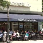 Outdoor seating in front of Boulevard Wood Grill