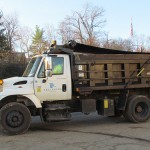 Truck with a full size load of mulch.