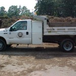Truck with a half size load of mulch.