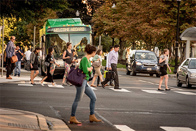 woman_crossing_street_near_bus
