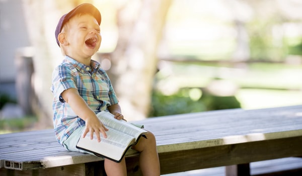 Boy Laughing with Book