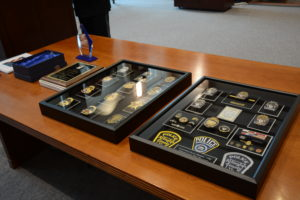 shadow box of badges