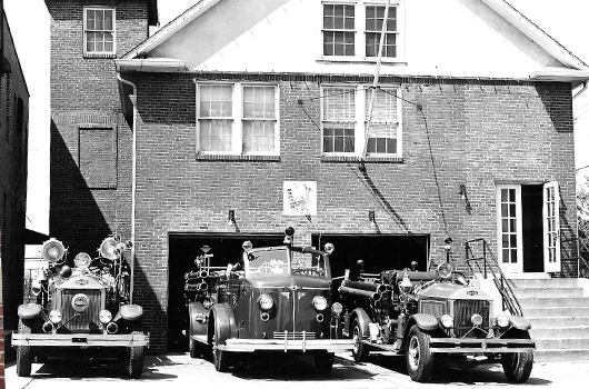 vintage trucks parked in front of station 5