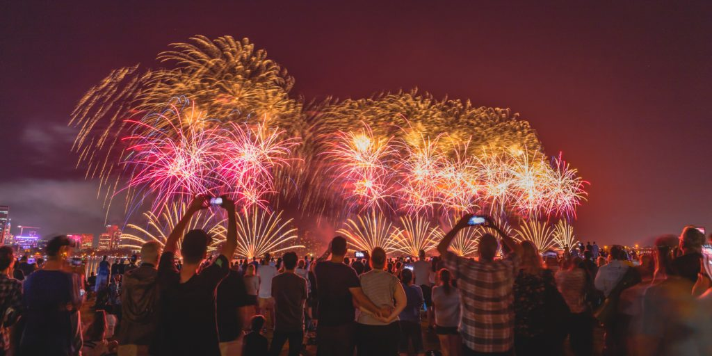 people watching fireworks Photo by Amarnath Tade on Unsplash