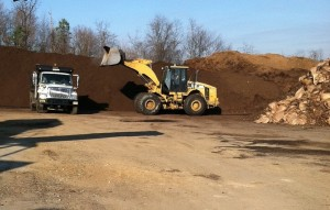 Trucks preparing for mulch delivery