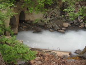 Stream with pollution from paint