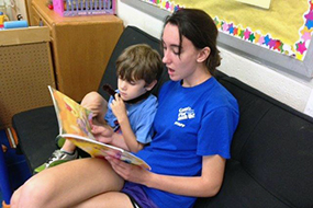 staff reading book to a child