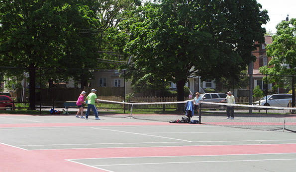 Walter Reed tennis courts with patrons
