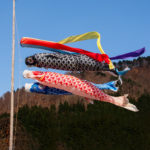 Koi flags wave by wind with blue sky.