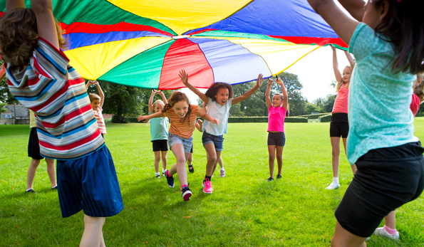 children playing with parachute 1