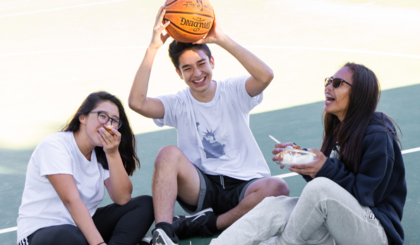 teens on basketball court sitting