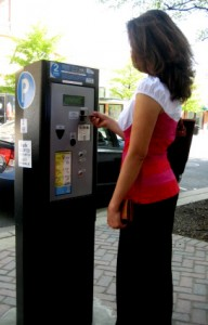 Resident paying with a credit card at a multispace meter.