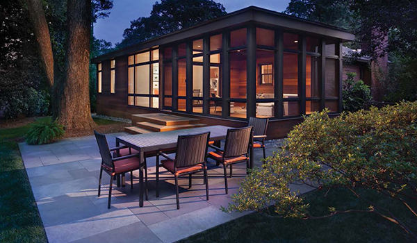 modern cedar living space addition overlooking backyard landscaping
