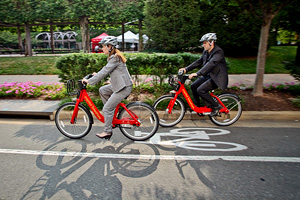 People riding Capital Bikeshare in a bike lane.