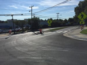 21st Street N/N. Quincy Street intersection - After: Relocated the non-ADA compliant crosswalk from the north side of the 21st Street N/N. Quincy Street intersection to the south side of the intersection and improved crosswalk safety by adding a curb extension, pedestrian median refuge, and improved street lighting. Street trees to be planted in the median during fall 2018.