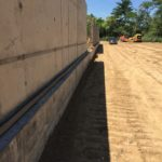 Backfill outside the North wall (50M pool area)