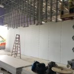 Drywall installation in the Group Exercise room.