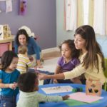 childcare instructors reading to children at daycare