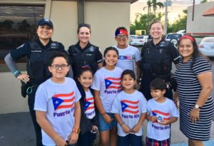 Arlington County police officers with children in Puerto Rico