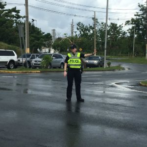 police officer stopping traffic in intersection