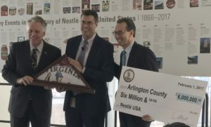 virginia governor with nestle execs and check