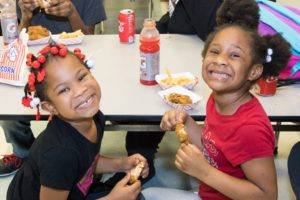 Young attendees enjoy A.R. Seafood's fried chicken.