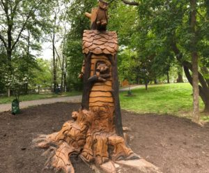 animals carved into tree