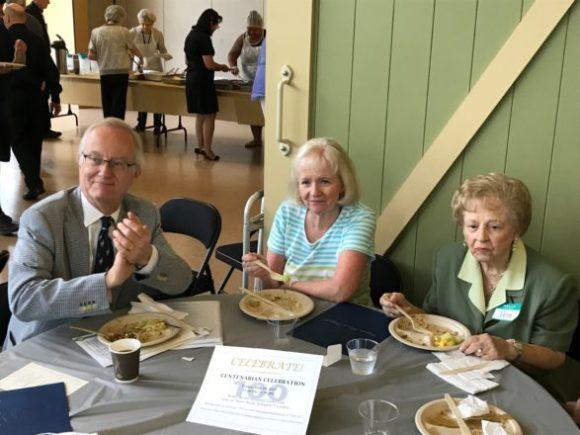 Three people sitting around table