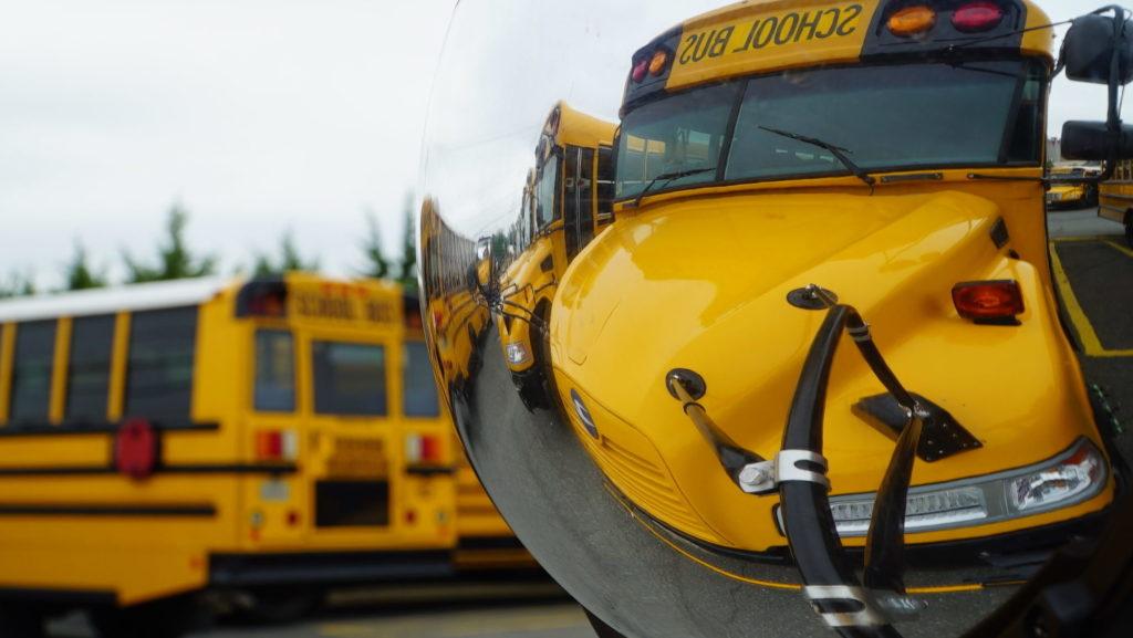 school buses in mirror
