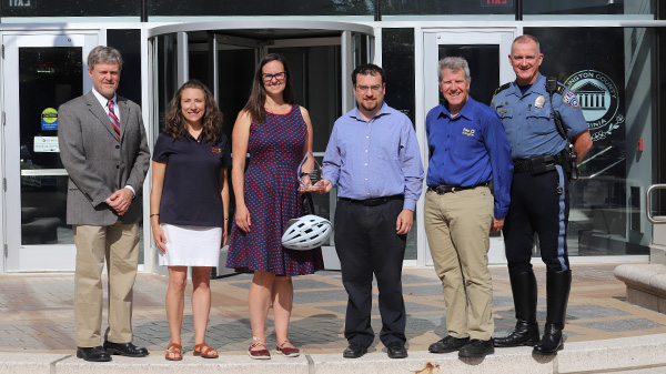 representatives from ACPD, DES, WalkArlington, BikeArlington, the Bicycle Advisory Commission and Pedestrian Advisory Commissions with the award