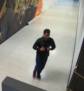 Surveillance image of male suspect wearing black clothing