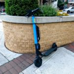 scooter leaning on planter in Courthouse area of Arlington.