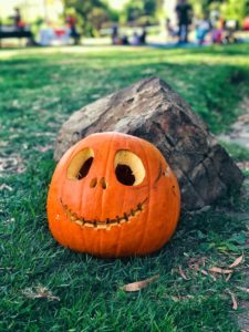 smiling jack-o-lantern against a rock