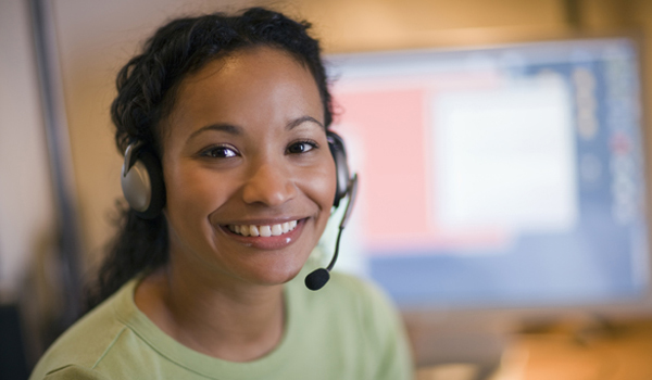 Customer service representative with headset and microphone.