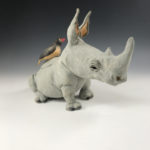 Rhino and Ox Pecker ceramic sculpture by Marsha Lederman