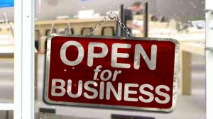 Photo of store sign that reads Open for business