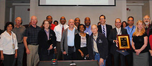 group of arlington county staff receiving award in county board room